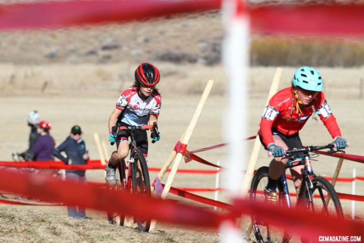 Haydn Hludzinski and Vida Lopez De San Roman battled back and forth during the race. Junior Women, 11-12. 2018 Cyclocross National Championships. © D. Mable/ Cyclocross Magazine