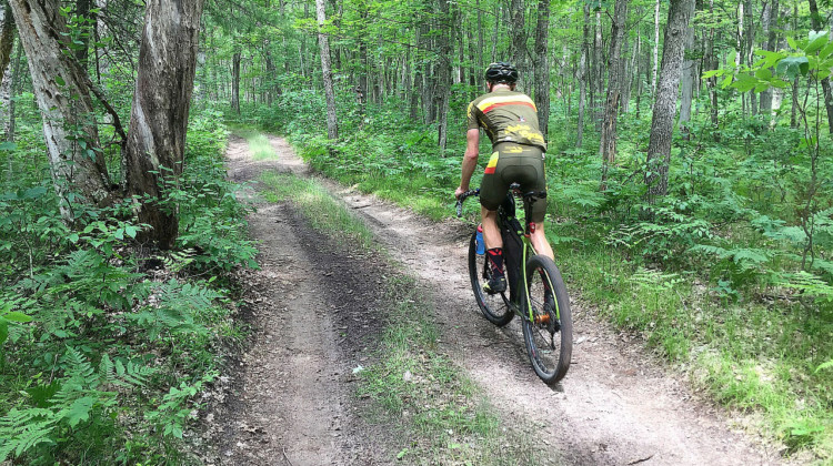 Salsa-sponsored rider Matt Acker testing out the Pine River ridge two-track. Photo courtesy of Coast to Coast Gravel Grinder