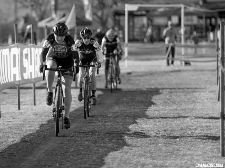 A line of riders heads down a straight made faster by the drying conditions. Masters Women 55-59. 2018 Cyclocross National Championships. © A. Yee / Cyclocross Magazine