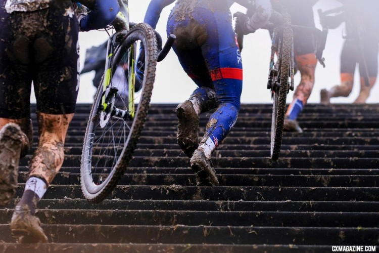 Riders head up the stairs. The course featured frequent dismounts. Junior Men, 2018 UCI Cyclocross World Championships, Valkenburg-Limburg, The Netherlands. © Gavin Gould / Cyclocross Magazine