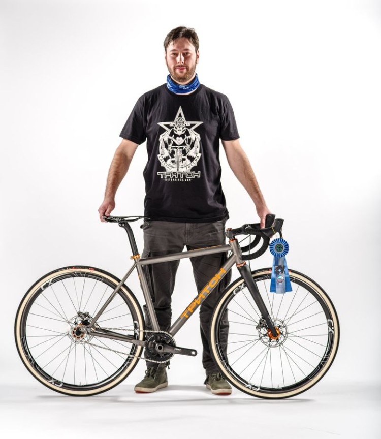 Demitry Nechaev of Triton Bicycles poses with his Best Cyclocross Bike Award-winning titanium singlespeed. 2018 North American Handmade Bike Show. photo: NAHBS
