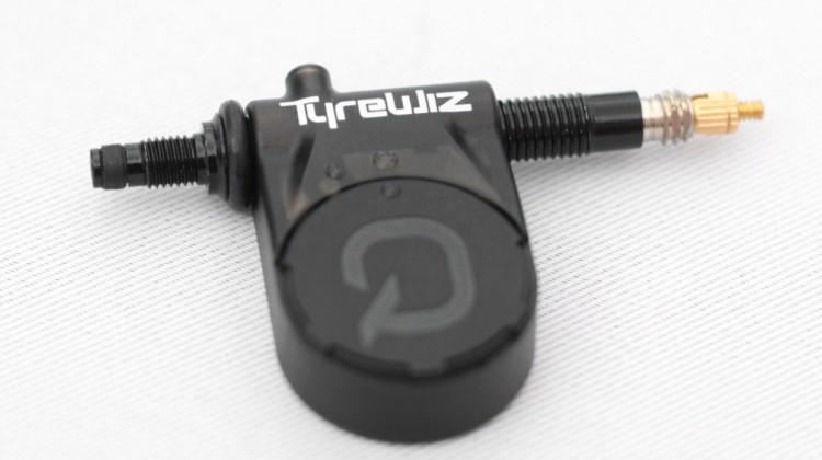 The new Quarq TyreWiz provides real-time tire pressure readings. Quarq TyreWiz Tire Pressure Sensor. 2018 Sea Otter Classic. © Cyclocross Magazine