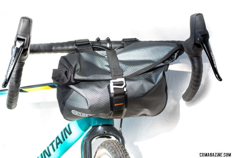 Two large water bottles, four energy bars and an extra layer all fit in the Accessory Pack, even if neatly rolling the top and locking it in place becomes a challenge. Ortlieb Accessory Pack. © Cyclocross Magazine