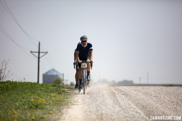 Many riders worked to find a clean line around the thick, freshly laid gravel. 2018 Almanzo 100 Gravel Race. © Eric Wynn