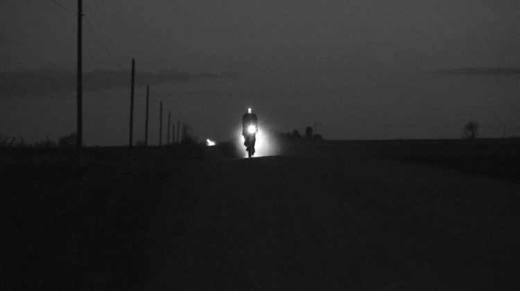 A rider blazes his way through the night along Iowa's gravel roads. 2018 Trans Iowa Gravel Race. © Jon Duke / Cyclocross Magazine