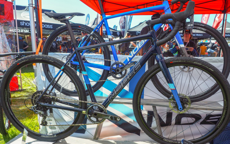 Noble has two gravel bikes. The carbon GX5 is in the foreground and the alloy GX3 is in the background. Both come with 1x SRAM drivetrains and Stan's Grail wheels. Noble Bikes Cyclocross and Gravel Bikes. 2018 Sea Otter Classic. © Cyclocross Magazine