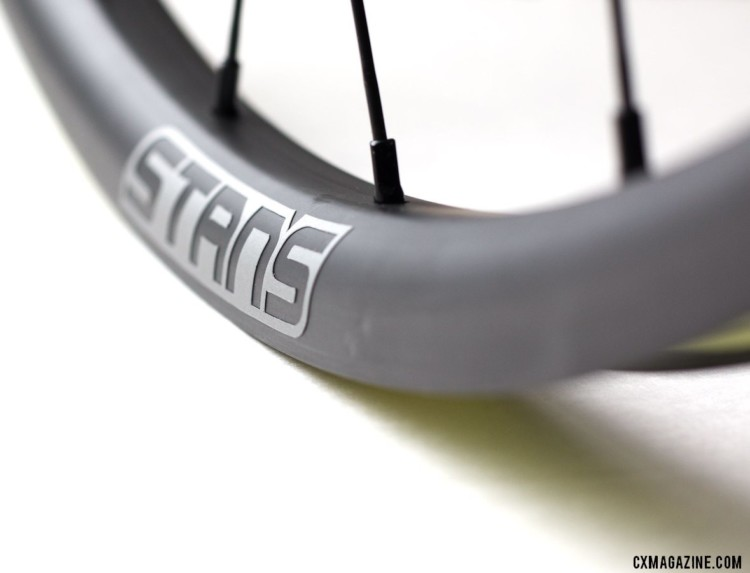 Our wheels had pre-production decals. The production wheels are said ot have thinner versions. Stan's NoTubes Grail CB7 carbon tubeless wheelset for gravel and cx. © Cyclocross Magazine