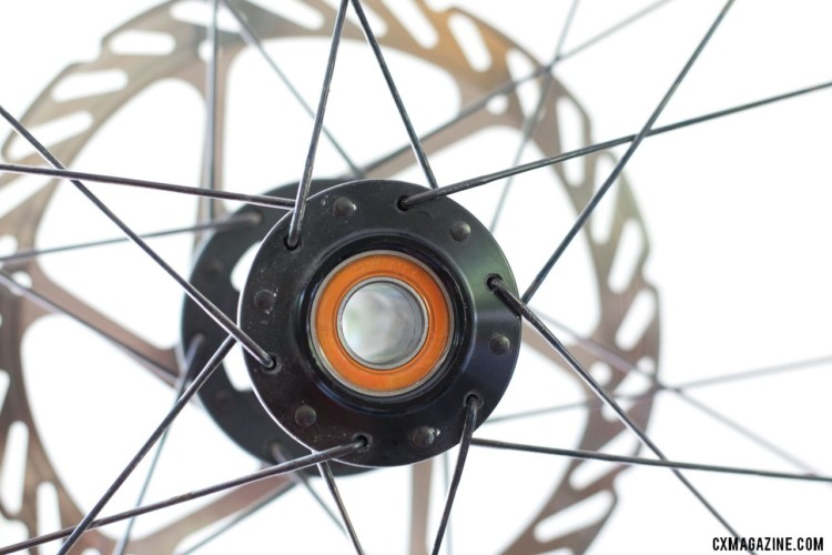 Pop the caps off the hub and you'll see the sealed cartridge bearings. Stan's NoTubes Grail CB7 carbon tubeless wheelset for gravel and cx. © Cyclocross Magazine