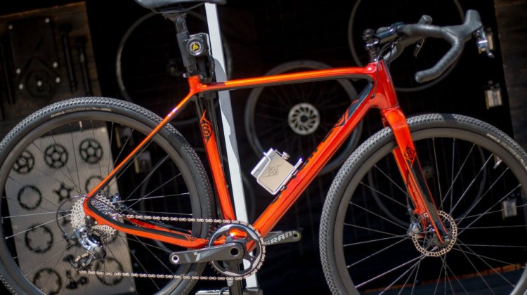 Origin8's Hellcat CX/GX carbon frameset features clearance for 44mm tires, options for rear QR or thru axle, and if you wish, a shiny stainless steel flask and holder. 2018 Sea Otter Classic cyclocross and gravel new products. © Cyclocross Magazine
