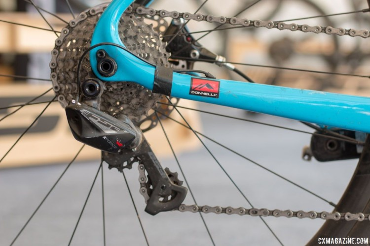 K-Force WE is wireless, but only from the shifter to the derailleur. The individual parts are still connected with wires to a central battery. Lance Haidet's FSA WE-equpped Pivot Vault, fresh off his Super G gravel race win. 2018 Sea Otter Classic. © Cyclocross Magazine