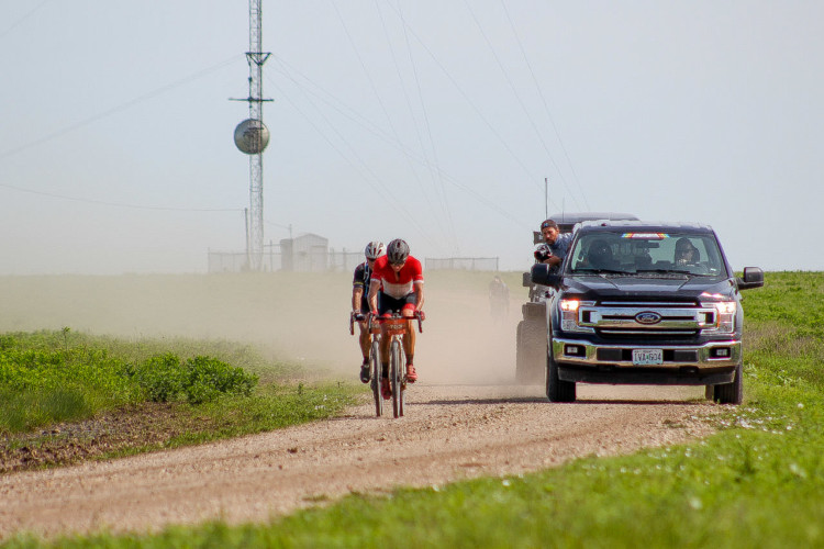 Nys had to chase back after his flats, towing a camera crew and the occasional lucky rider. 2018 Men's Dirty Kanza 200. © Z. Schuster / Cyclocross Magazine