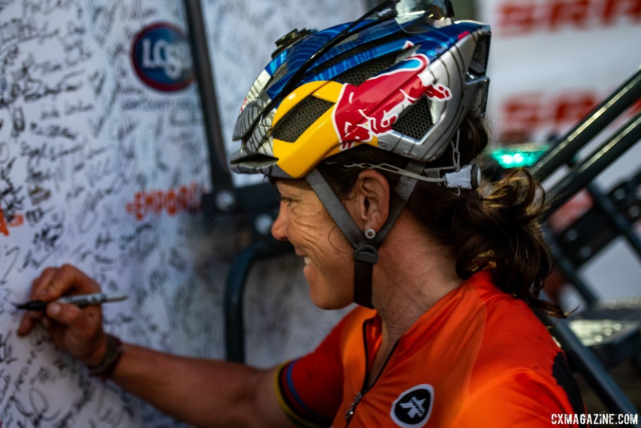 Rebecca Rusch signs her name on the finisher board after winning the DKXL. 2018 Dirty Kanza 200. © Ian Matteson/ ENVE Composites