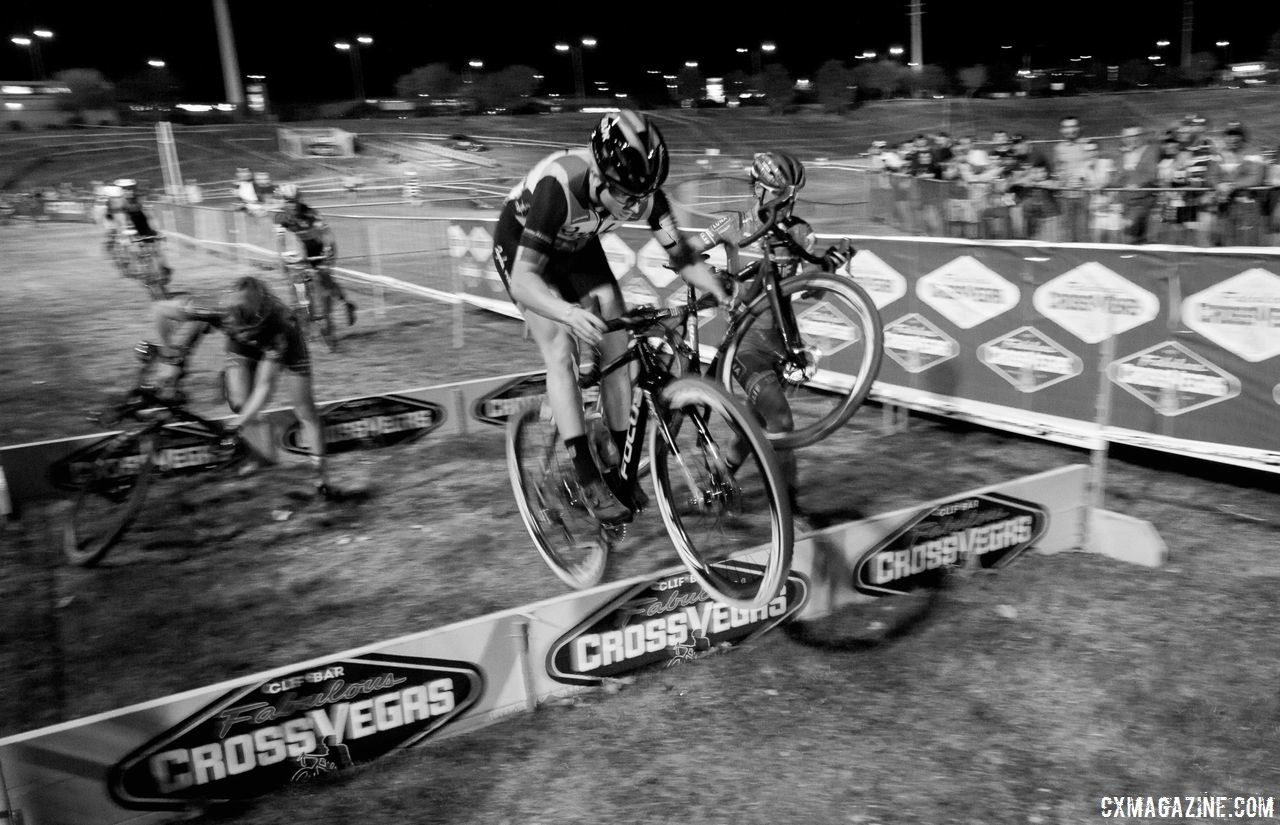 Ellen Noble hops the barriers while other earthbound riders struggle around her. 2017 CrossVegas. © A. Yee / Cyclocross Magazine