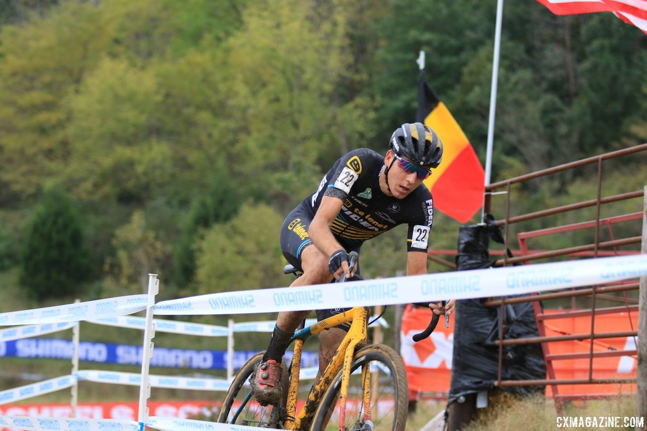 Nicolas Cleppe rides solo in the shadow of the Belgian flag. 2018 Jingle Cross Day 3, Sunday. © D. Mable / Cyclocross Magazine