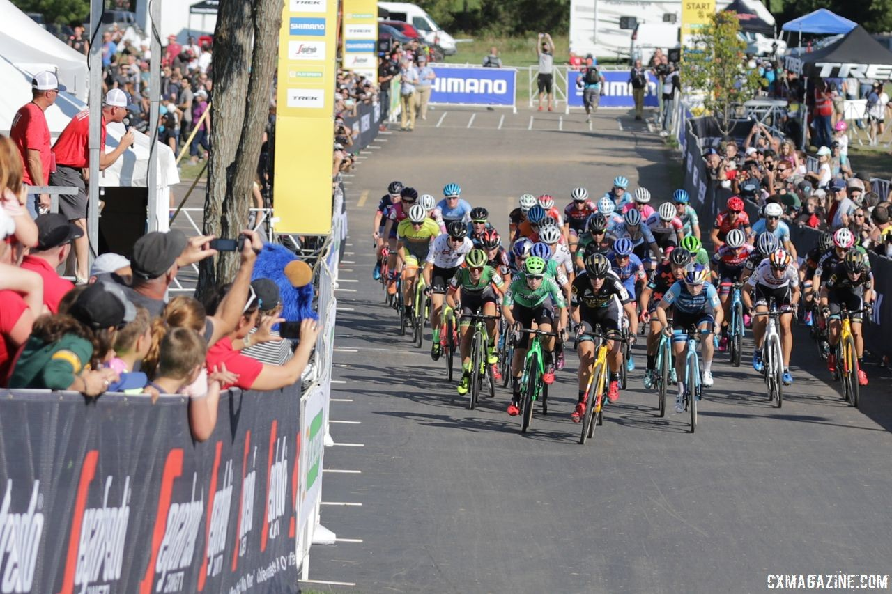 The women rip through the holeshot in the marquee time slot in Waterloo. 2018 World Cup Waterloo. © R. Clark / Cyclocross Magazine
