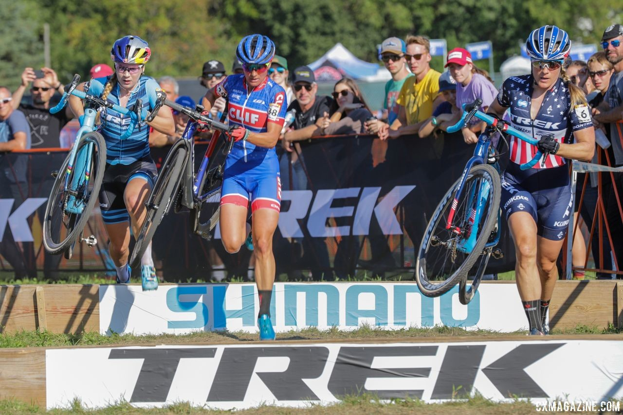 The chase of Richards, Nash and Compton hits the barriers. 2018 World Cup Waterloo. © R. Clark / Cyclocross Magazine