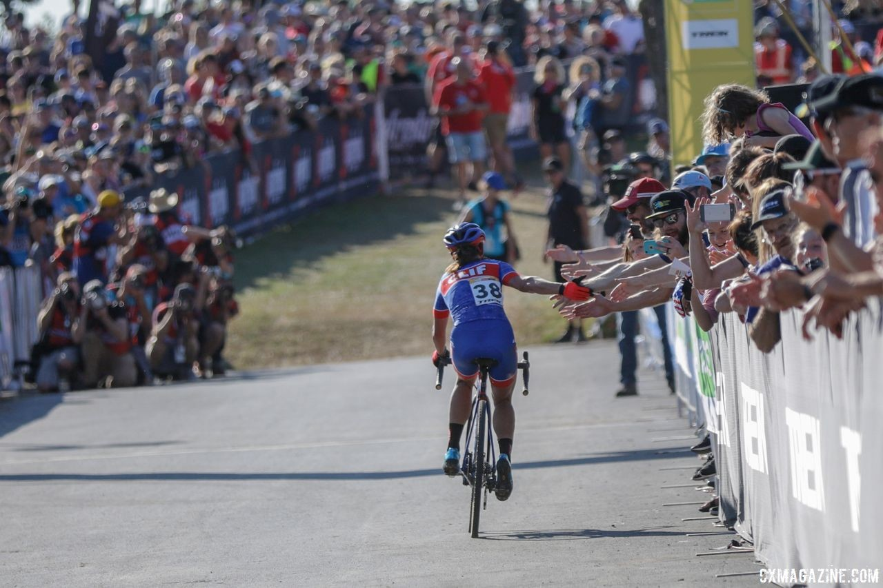 Katerina Nash gives out high fives after her third-place finish. 2018 World Cup Waterloo. © R. Clark / Cyclocross Magazine