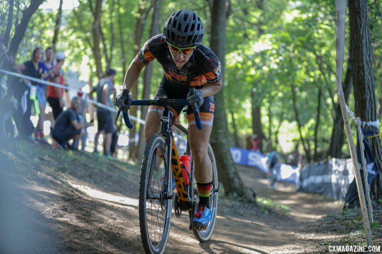 Arley Kemmerer pushes through the woods. 2018 World Cup Waterloo. © R. Clark / Cyclocross Magazine