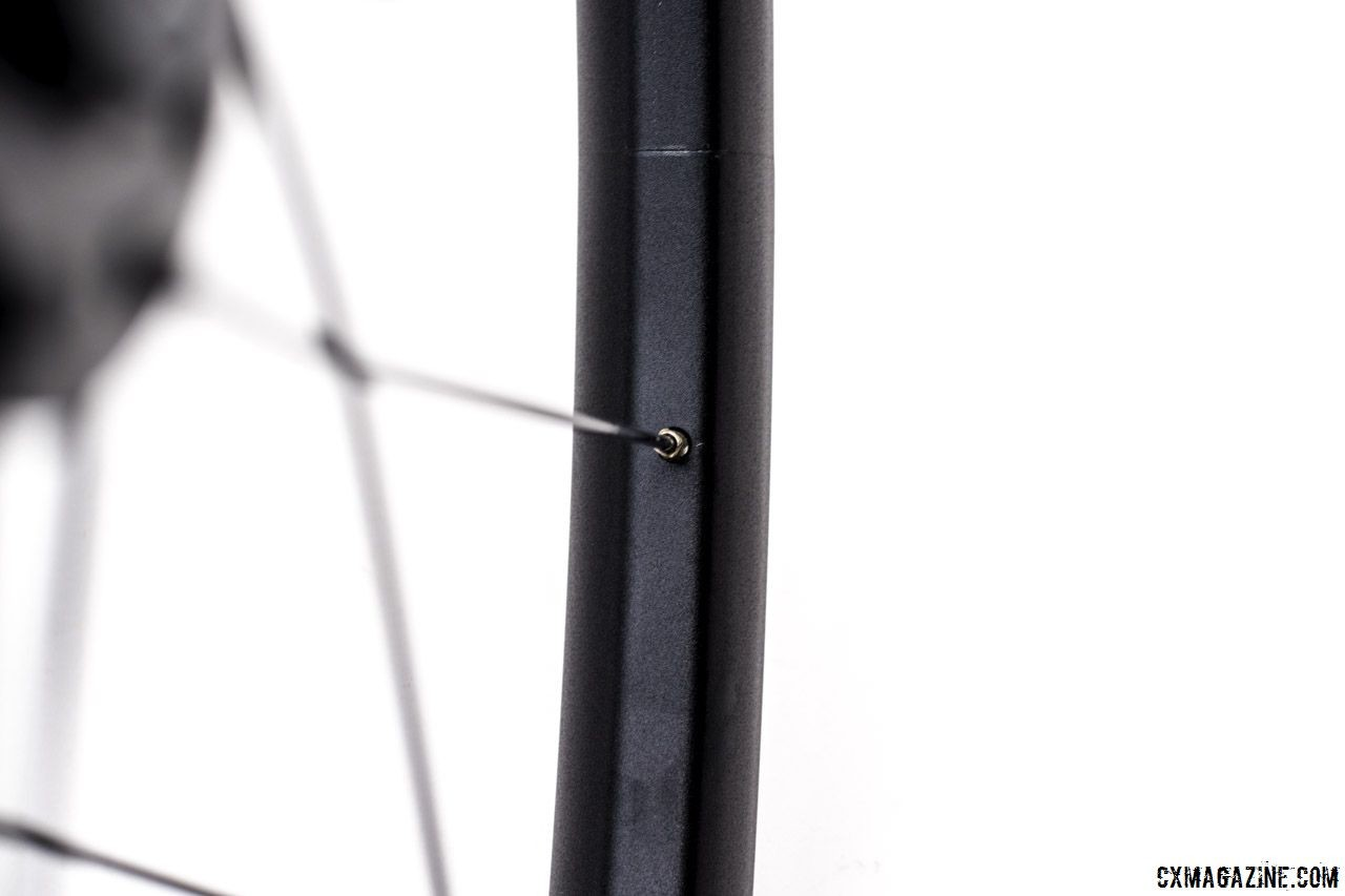 The FSA NS rim is asymmetric with a welded seam. Spokes are double butted with external brass nipples. FSA NS Alloy Wheelset. © Cyclocross Magazine / C. Lee