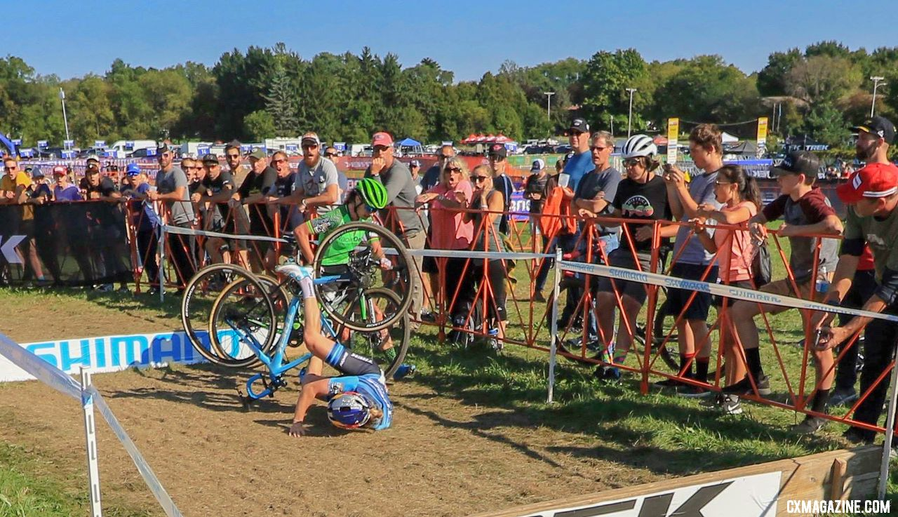 Ellen Noble tumbles and tangles with Marianne Vos at the barriers. © D. Mable / Cyclocross Magazine