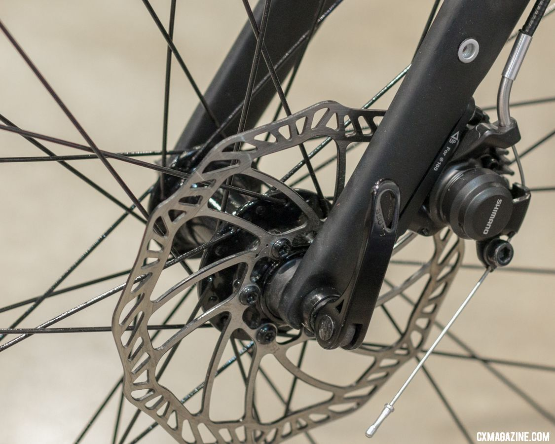 Flat mount disc brakes juxtaposed with quick release dropouts show how fast things can change in bike standards. 2018 Interbike. © E. Takayama / Cyclocross Magazine