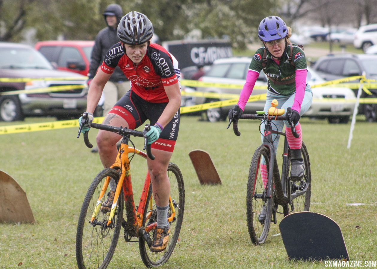 Emily Nordahl and Holly LaVesser make their way through the grave yard in Lap 2. 2018 Cross Fire, Sun Prairie, Wisconsin. © Z. Schuster / Cyclocross Magazine