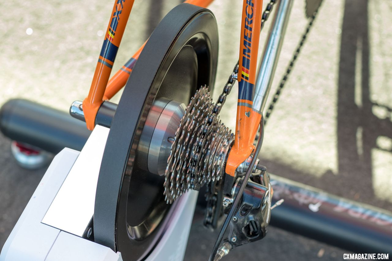 Minoura's Kagura SmartTurbo trainer features a stainless steel forged flywheel, with a flat belt that is said to be 20-25% quieter than other notchet belts. 2018 Interbike new products. © Cyclocross Magazine