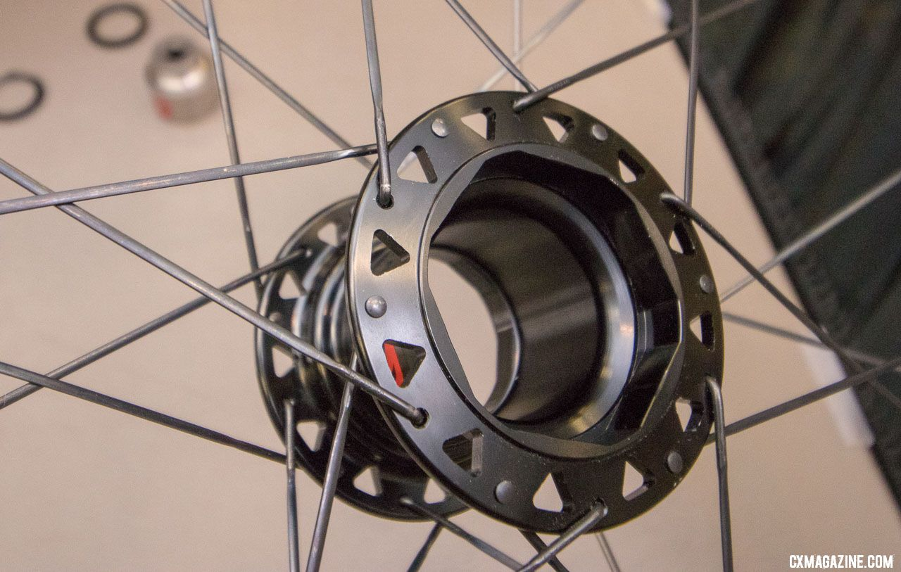 Two Point Zero's Phoenix modular hub allows allows you to swap your 700c alloy wheels for carbon tubulars, 650b gravel wheels, or aero section rims and still use your same cassette and rotor. There's a weight penalty, but potential time savings due to less brake and shifting adjustments. 2018 Interbike new products. © Cyclocross Magazine