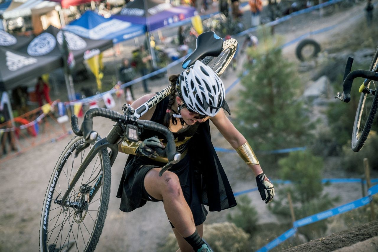 Batwoman conquers the railroad ties. 2018 Cyclocross Crusade Halloween Race at Deschutes Brewery, Bend, OR. © Ben Guernsey
