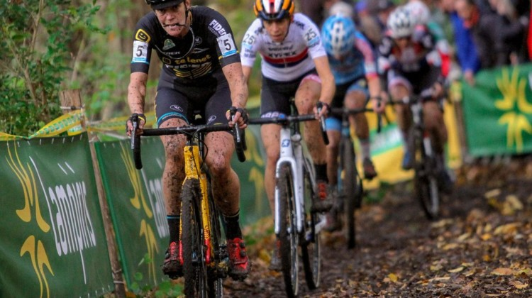 Ellen van Loy creatively saving her glasses until the pits. She finished lucky 13th, but was unlucky in hitting the ground several times . © B. Hazen / Cyclocross Magazine