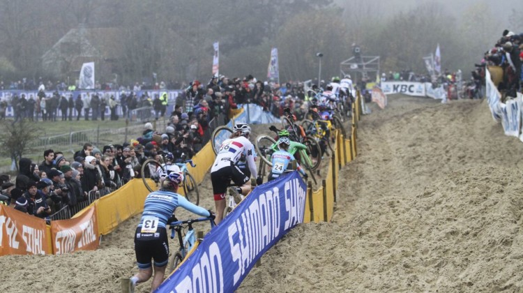 Noble joins a long train of riders running through the sand. 2018 World Cup Koksijde. © B. Hazen / Cyclocross Magazine