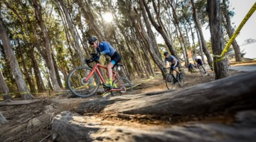 Riders go over an obstacle. 2018 Coyote Point Cyclocross Race 1, San Mateo, California. © J. Vander Stucken / Cyclocross Magazine