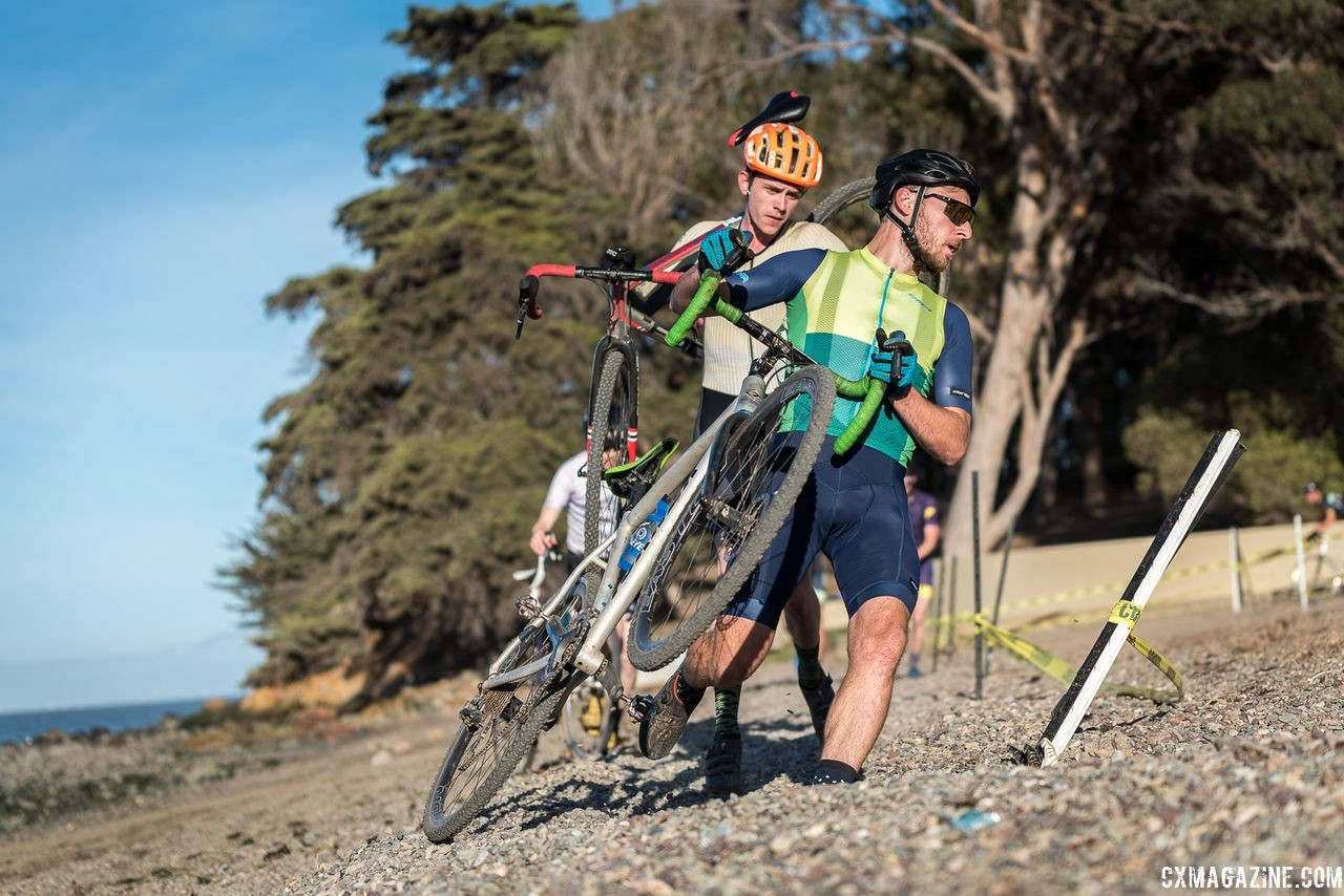 Riders take a corner on foot. 2018 Coyote Point Cyclocross Race 1, San Mateo, California. © J. Vander Stucken / Cyclocross Magazine