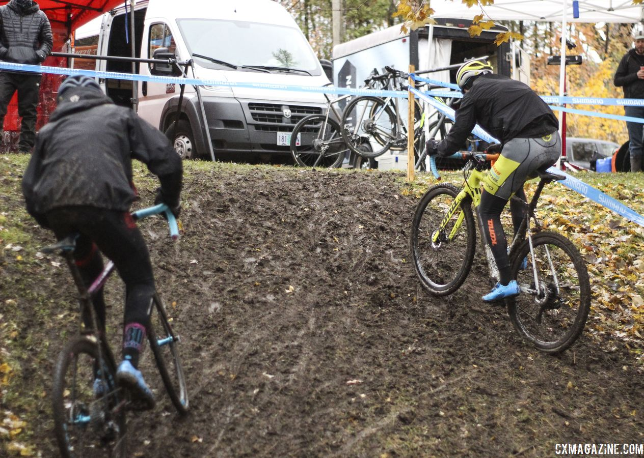 Kerry Werner spent some time showing Nathan Knowles the ropes during pre-ride. Here he shows how to ride the muddy incline. 2018 Silver Goose CX Course Inspection, Friday. © Z. Schuster / Cyclocross Magazine