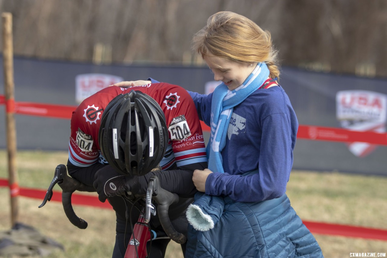 Paul McKeithan's grand daughter greets him after his win. Masters Men, 70+. 2018 Cyclocross National Championships, Louisville, KY. © A. Yee / Cyclocross Magazine