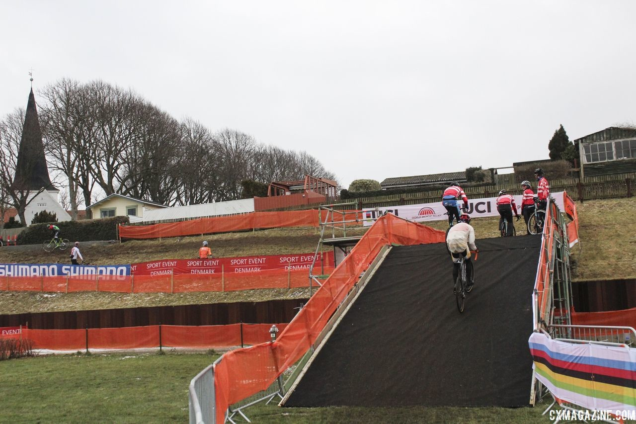 Flyovers are necessary to get up and over the 10-foot seawall. 2019 Bogense World Championships Course Preview. © Z. Schuster / Cyclocross Magazine