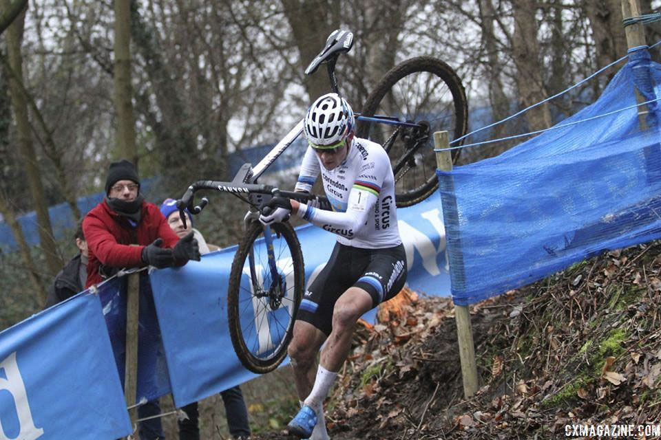 Mathieu van der Poel turns one of downhill corners in the woods. 2019 Brussels Universities Cyclocross. © B. Hazen / Cyclocross Magazine