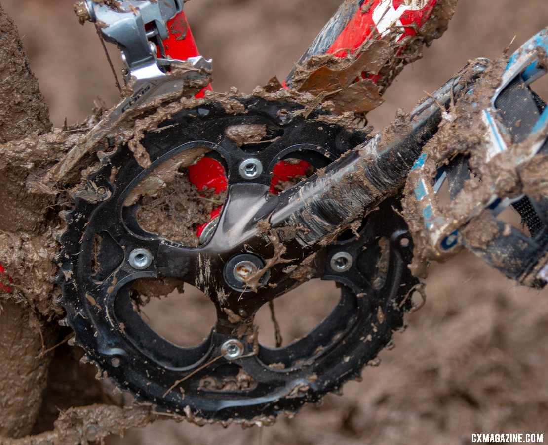 A Claris drivetrain with a Sugino double crankset featuring 38/48 chainrings provides plenty of gear inches for the strongest future champs despite the small wheels. Miller Reardon's Redline Conquest 24. 2018 Cyclocross National Championships, Louisville, KY. © A. Yee / Cyclocross Magazine