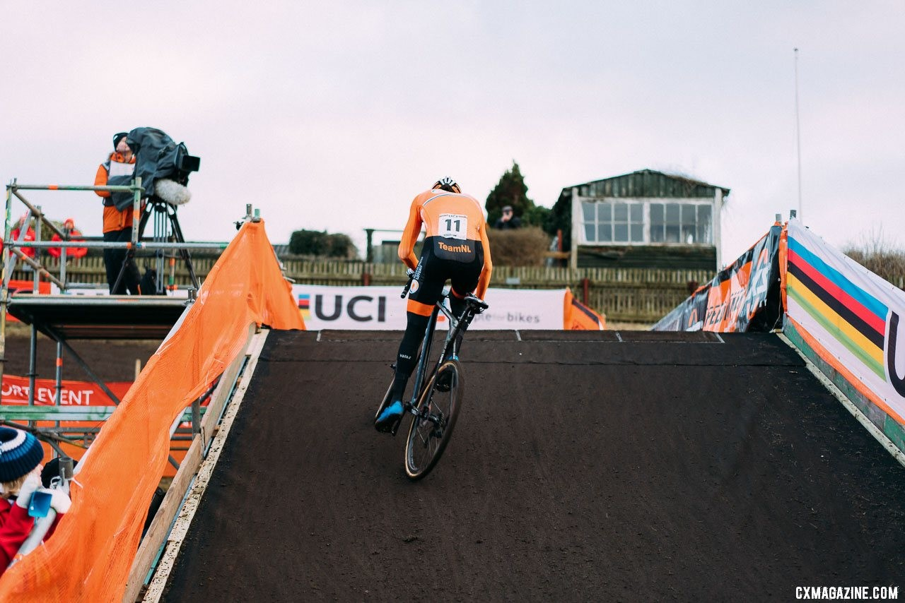 Mathieu van der Poel in control, scaling the muddy flyover. 2019 Cyclocross World Championships, Bogense, Denmark. © Taylor Kruse / Cyclocross Magazine
