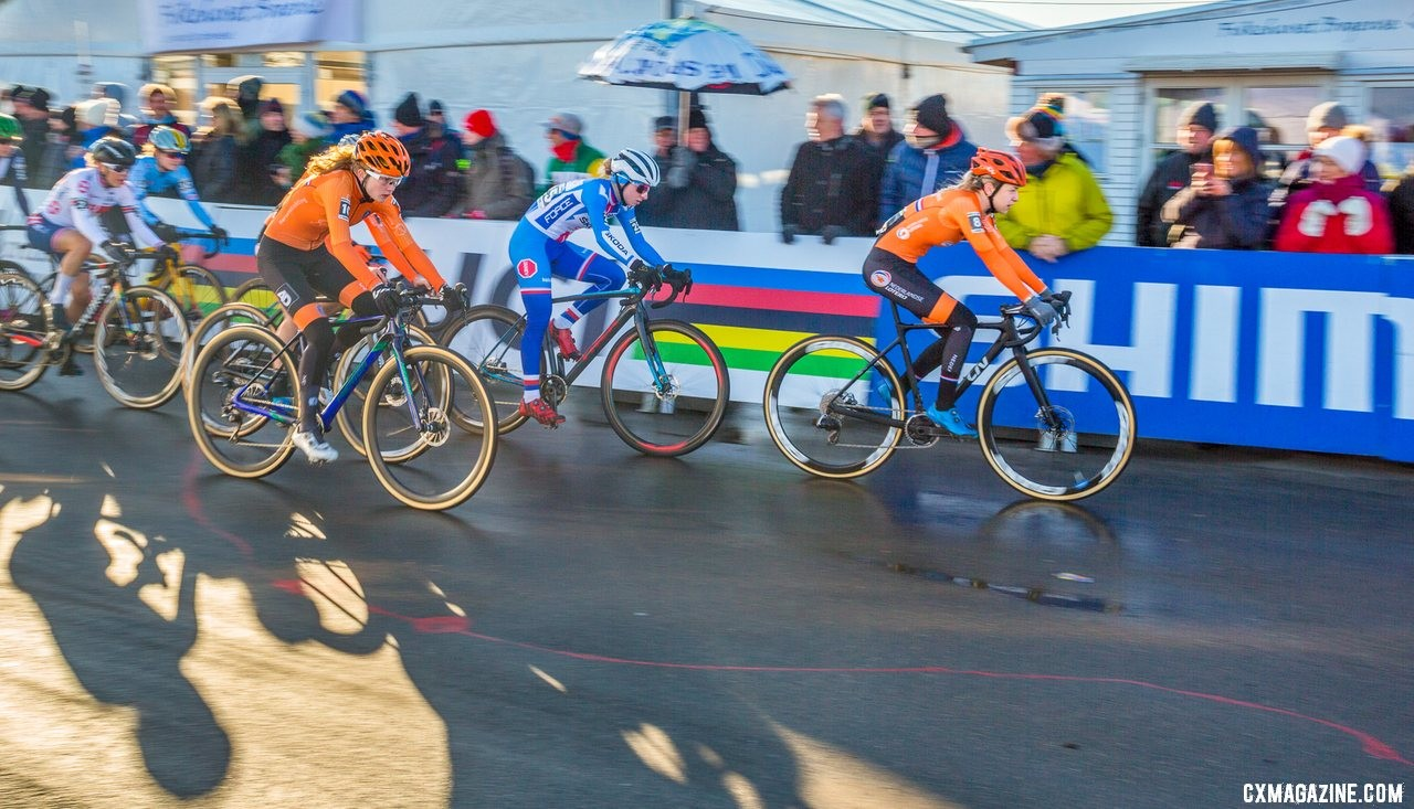 The pavement brought out pack racing, with many rejoining to seek shelter from the wind. U23 Women. 2019 Cyclocross World Championships, Bogense, Denmark. © K. Keeler / Cyclocross Magazine