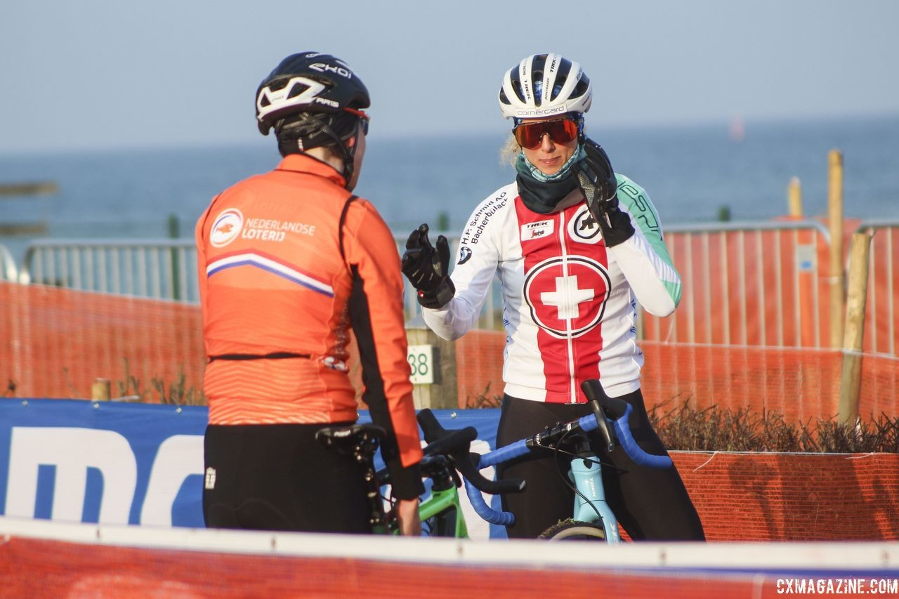 After Maud Kaptheijns encouraged Jolanda Neff to hop the barriers, the two talk strategy. 2019 Bogense World Championships Course Inspection, Friday Morning. © Z. Schuster / Cyclocross Magazine