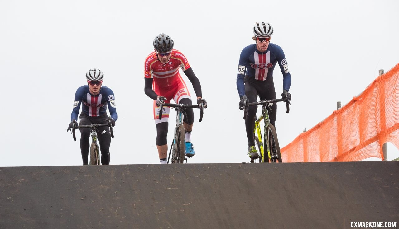 Spencer Petrov and Cooper Willsey sandwich a Danish rider on their way across a flyover. 2019 Cyclocross World Championships, Bogense, Denmark. © Cyclocross Magazine