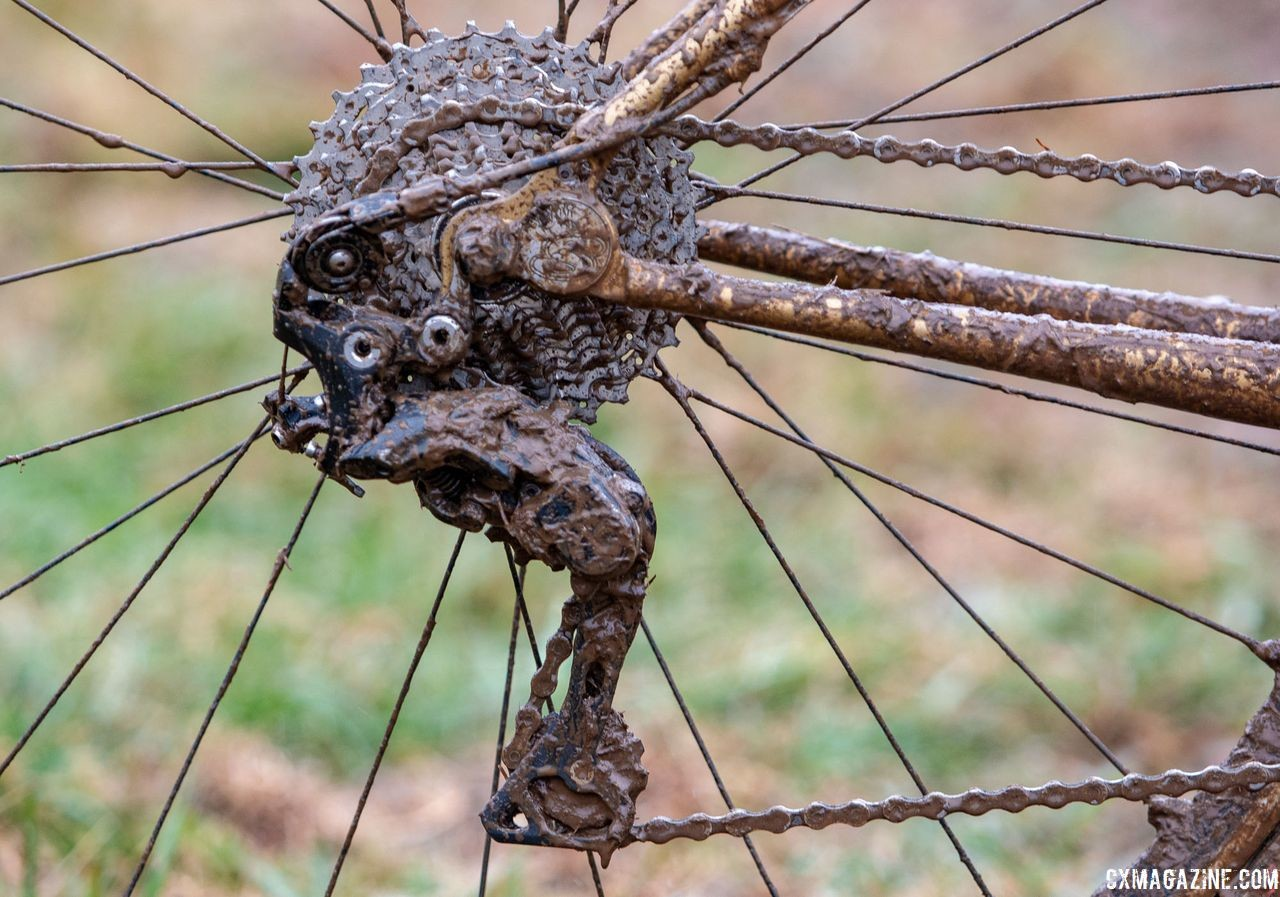 Until the RX800 derailleur was released, devices like this Wolf Tooth Tanpan were required to use a Shimano mountain derailleur and gain a clutch. Vida Lopez de San Roman's Sycip cyclocross bike. 2018 Cyclocross National Championships V2. Louisville, KY. © Cyclocross Magazine