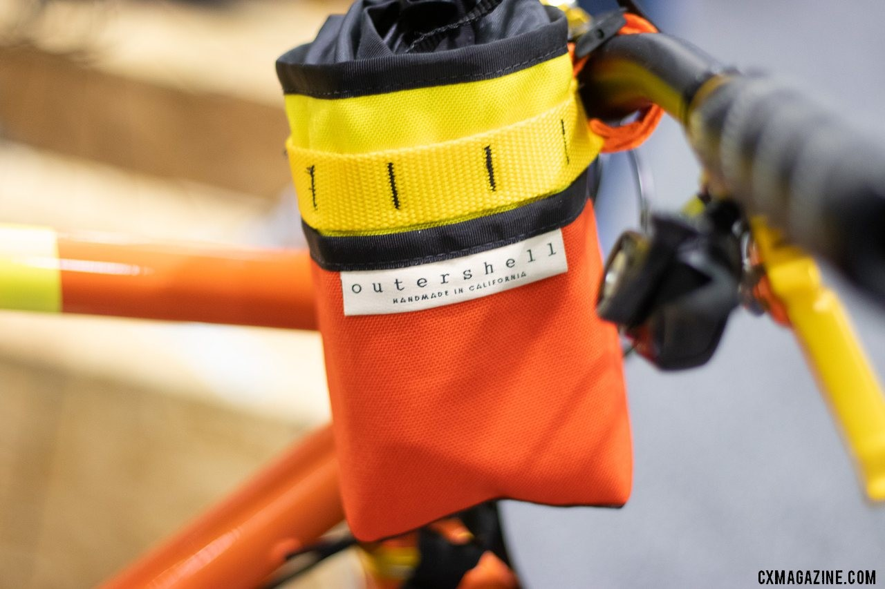 Fan of cold drinks on a ride, or Magnup P.I.'s MD500D helicopter? Outershell's Stem Caddy matched his bike and the famous 'copter. $55. 2019 NAHBS Sacramento. © A. Yee / Cyclocross Magazine