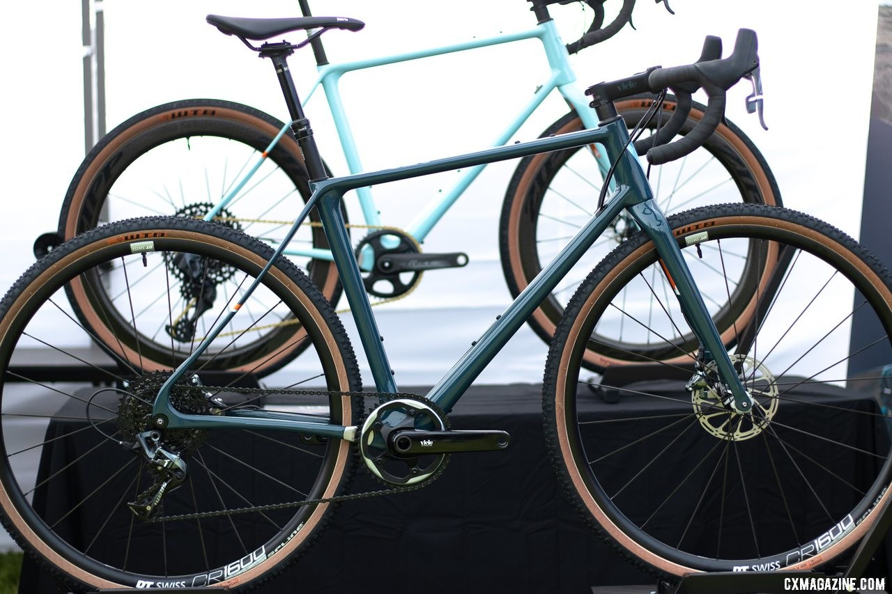 The Vielo V+1 UDG carbon gravel bike (foreground) is a slightly heavier, more affordable version of the UD in the back. Frames are identical in geometry and features. 2019 Sea Otter Classic. © A. Yee / Cyclocross Magazine