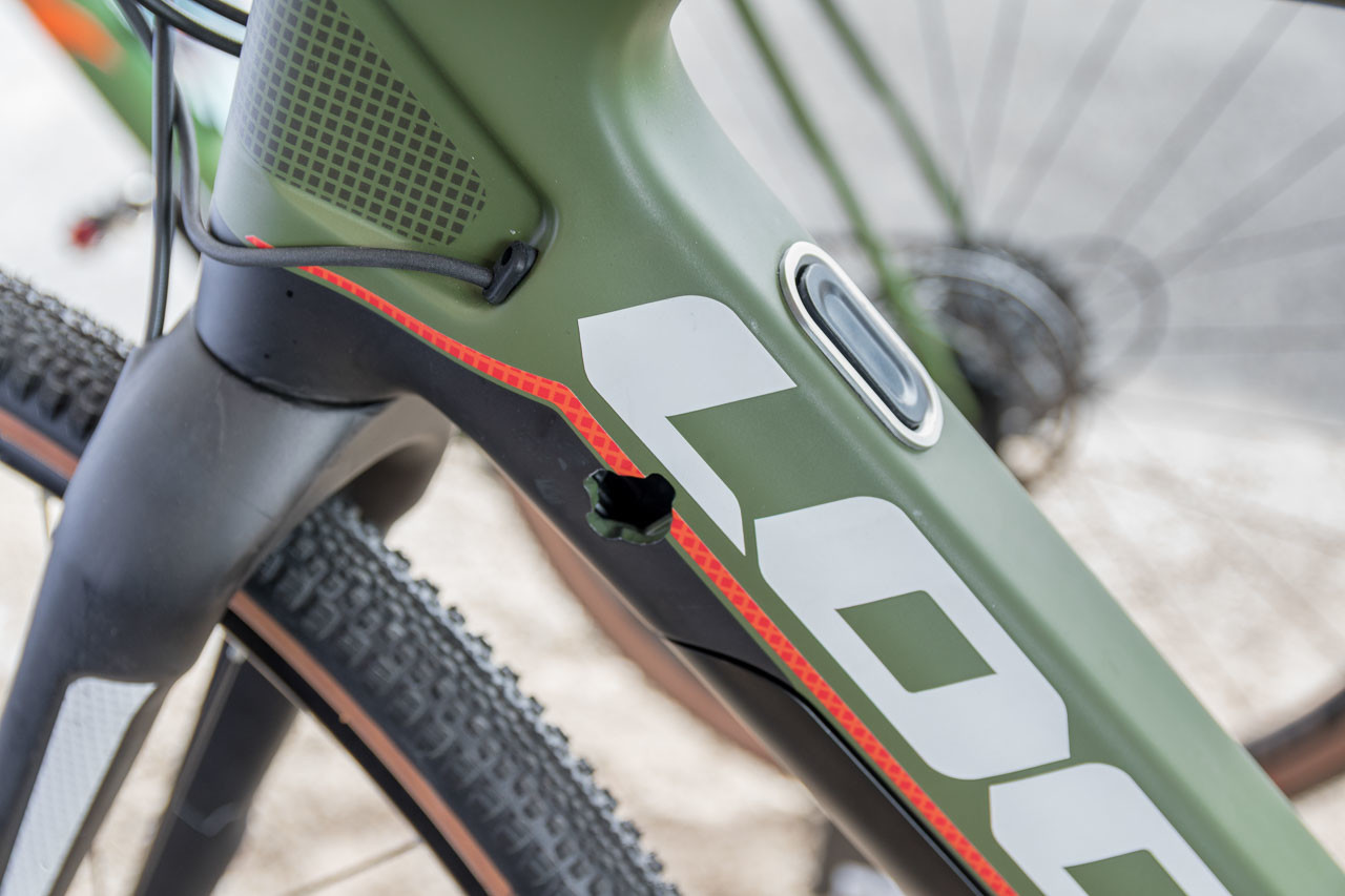 The hole is for a lock to hold the downtube batter in place, the button releases the battery and motor pack. Look E-765 Gravel RS Gravel Bike, 2019 Sea Otter Classic. © C. Lee / Cyclocross Magazine