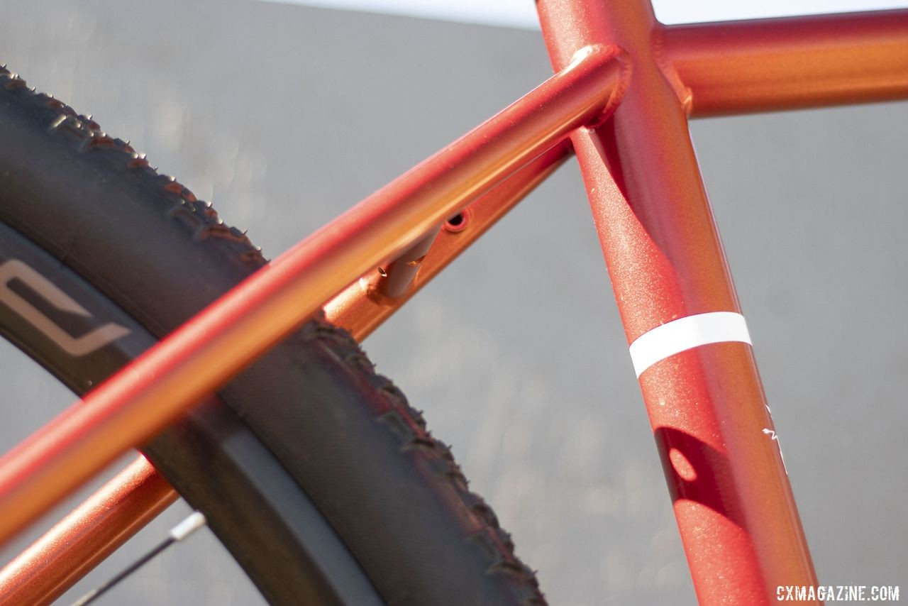 Van Dessel's newest do-it-all bike, the Day Ripper, has a metallic orange finish that sparkles in the sun. 2019 Sea Otter Classic. © A. Yee / Cyclocross Magazine