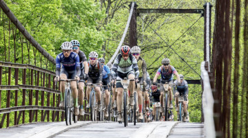 Riders make their way over a bridge during The Epic. 2019 The Epic Gravel Race, Missouri. © Studio T Images
