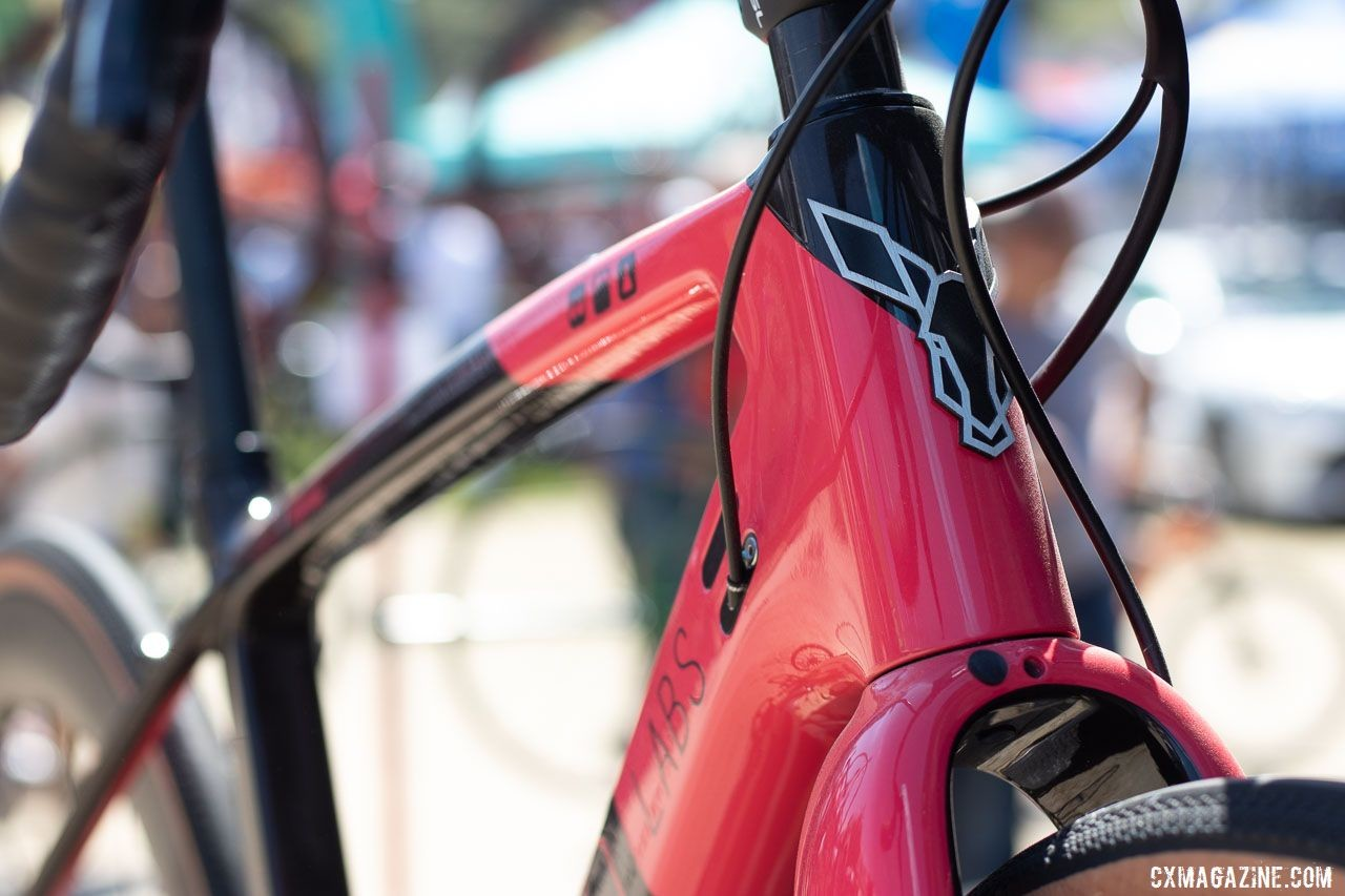 """Rodeo Labs was showing off a Trail Donkey 3.0 Rapha edition. The pink color scheme and """"ex duris gloria"""" (glory through suffering) on the chainstay will cost you a cool $200 extra. 2019 Sea Otter Classic. © Cyclocross Magazine"""