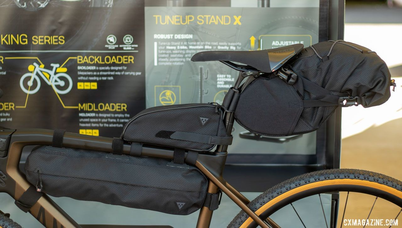 Topeak is all-in on the bikepacking movement. Its BackLoader and MidLoader bags help you avoid backpacks or trailers and get to camp. The MidLoader carries 6 liters (of gear, or beverage) and retails for $69.95. There are 6 and 4.5 liter versions available. The BackLoader hauls up to 15 liters and retails for $89.95 © A. Yee / Cyclocross Magazine
